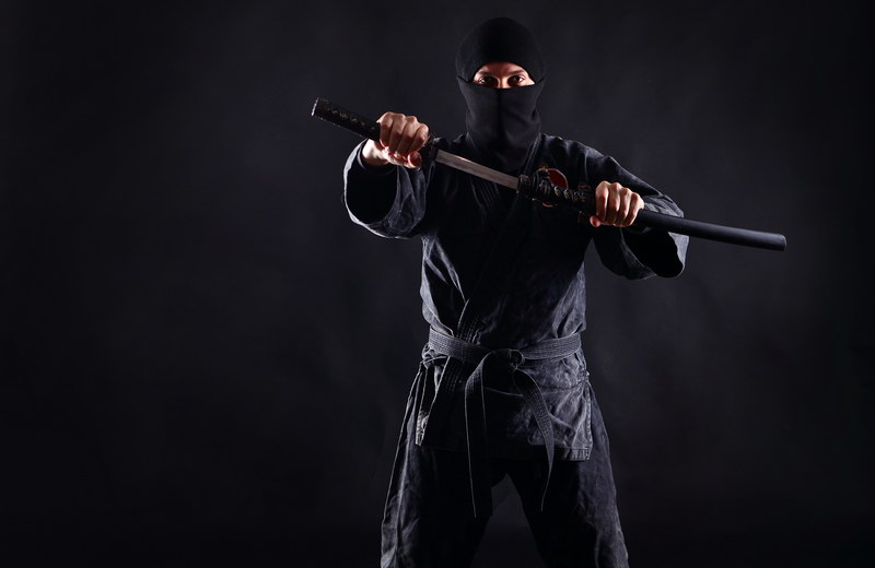 Ninja with katana black background