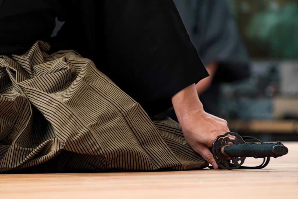 Samurai kneeling with katana