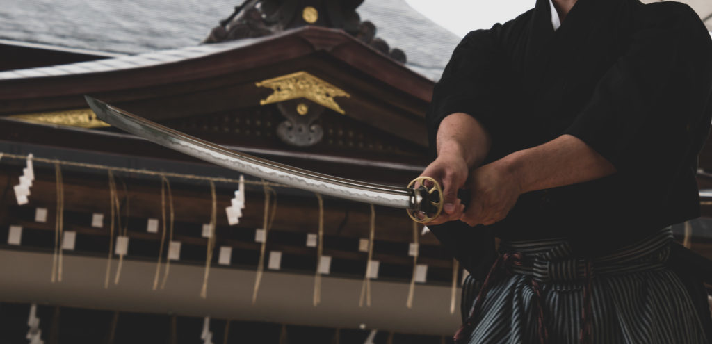 Samurai with Katana in front of temple